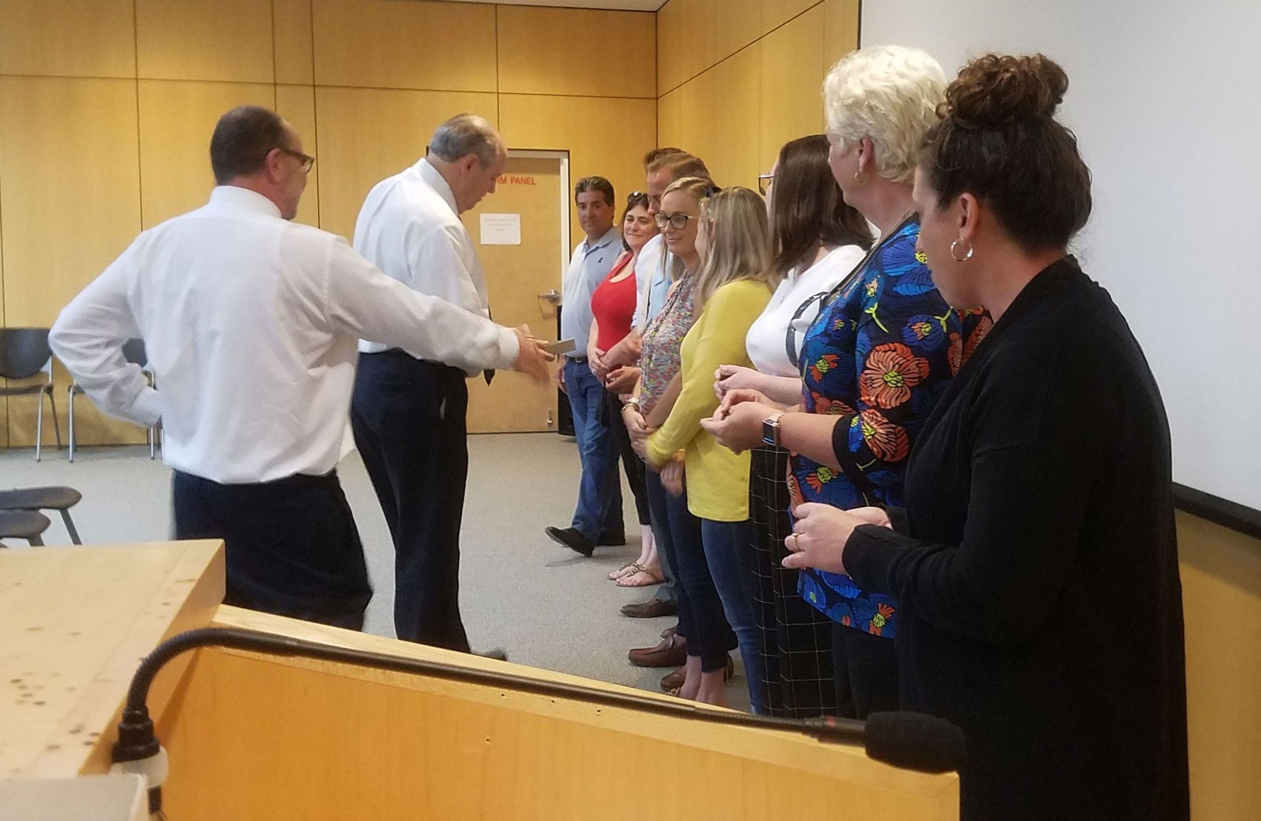 State Attorney's Office staff receives pins for their years of service.